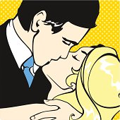 Kissing couple on a yellow background