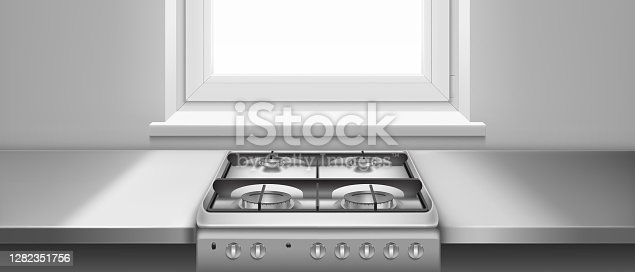 istock Kitchen table and gas stove with hobs 1282351756