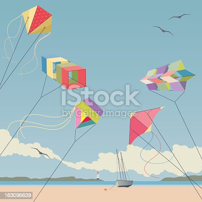 Five colourful kites flying on a summer's dayat the beach.