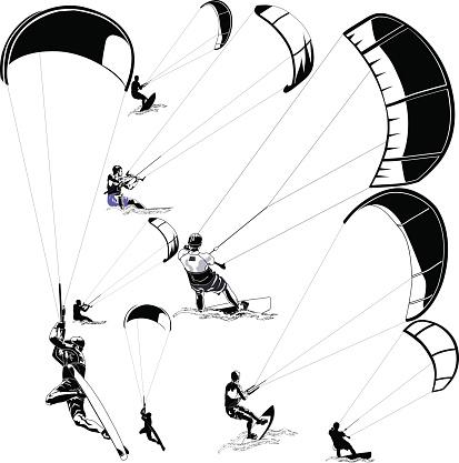 Kitesurfers on white