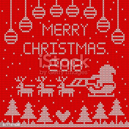 istock Knitted merry Christmas 2018 on red background design. 877767836