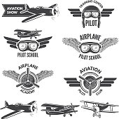 Labels set with illustrations of vintage airplanes. Travel pictures and  for aviators. Aviation flight badge, airplane emblem, pilot school  vector
