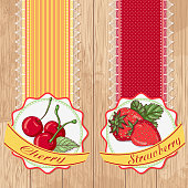 Vector illustration set of labels with cherry and strawberries on a wooden background. Design in retro style for restaurants, cafes, cookbooks