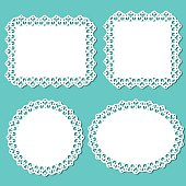 White lace doilys and frames.