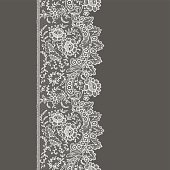 Lace ribbon. Vertical seamless pattern.