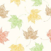 Vector illustration of lacey fall leaves on a cream colored background.