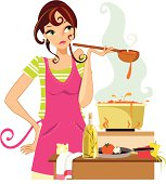 A pretty young woman is pleased with the aromas of her cooking