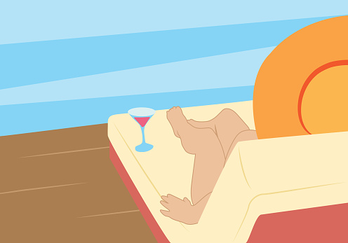 lady sunbathing on a chaise longue by the water
