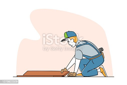 istock Laminate Flooring Service. Worker with Tools Sitting on Floor Fitting Laminate Pieces. House Work, Handyman Business 1273822329