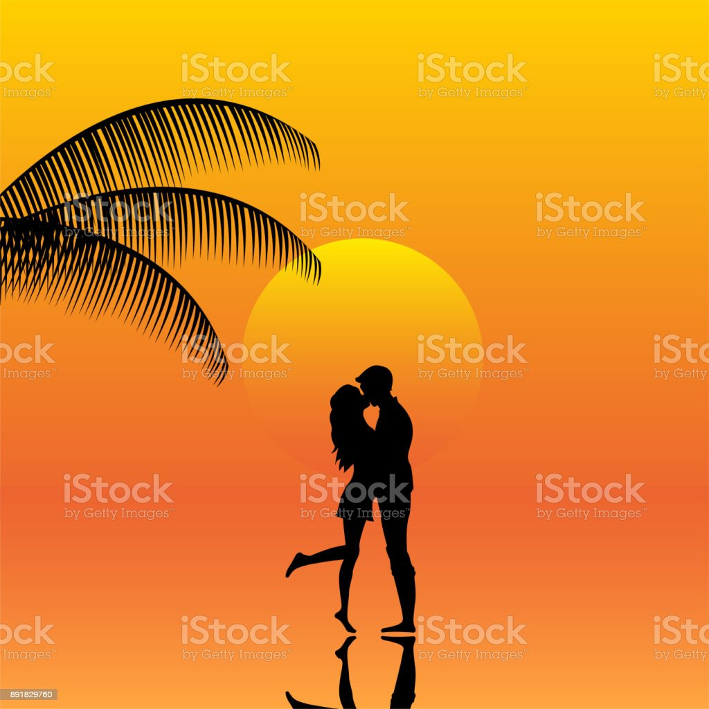 Landscape Of Couple In A Sunset On The Beach Stock