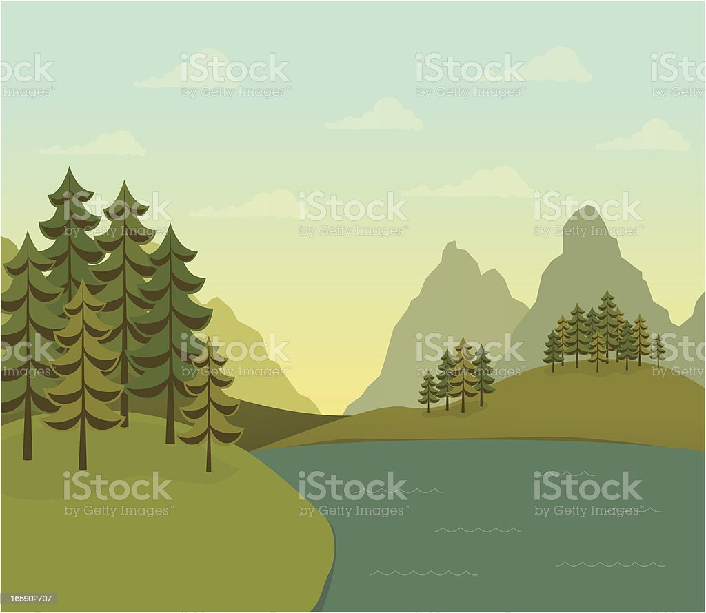 Landscape of evergreen trees with lake and mountains