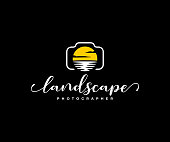 Landscape photographer design. Digital camera and lens in the form of sun and water vector design. Nature photographer illustration