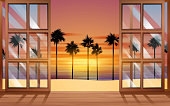 landscape of the beach in sunset at the windows