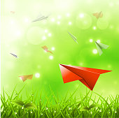 Paper airplane flies above meadow .EPS 10. Elements are layered. Easy to edit. Opacity and transparency used.