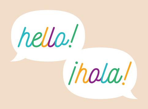 Language translation speech bubbles from English to Spanish.