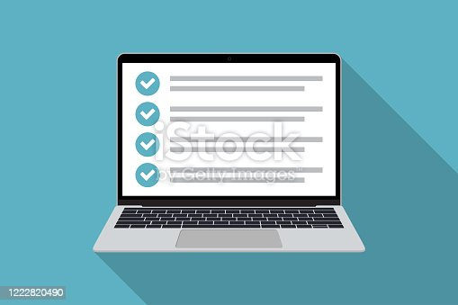 istock Laptop with checklist in a flat design with long shadow. List with checkboxes 1222820490
