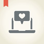 Laptop with heart icon,vector illustration.
