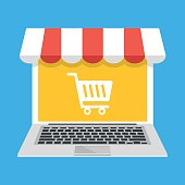 Laptop with white shopping cart icon on screen and storefront awning. E-commerce, ecommerce, online shopping, online store concepts. Modern flat design graphic elements. Vector illustration