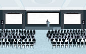 Vector illustration of large conference room with silhouetted chairs, attendees and speaker at podium. Three large blank projection screens ideal for copy space. Download includes Illustrator 8 eps with elements neatly arranged on separate layers, high resolution jpg and png file. See my portfolio for other conference and business related illustrations.