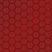 Large red hexagon honeycomb pattern reflecting light.
