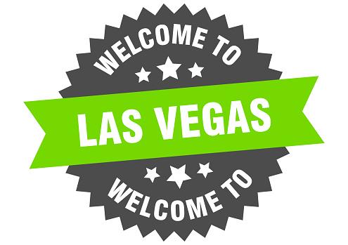 Las Vegas sign. welcome to Las Vegas green sticker