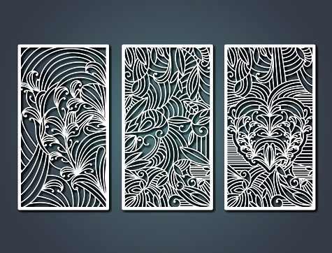 laser cutting rectangular frames with decorative floral forms in steel blue color background