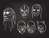 Chalkboard variety of scary faces for Halloween