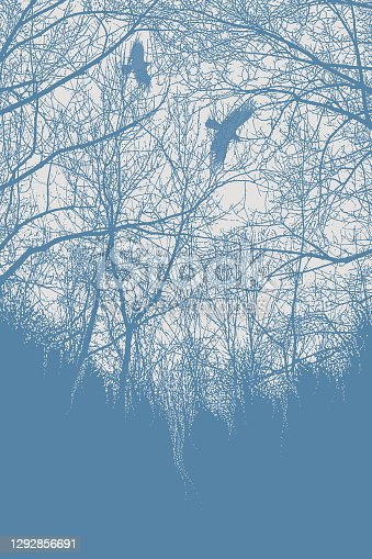 istock Late autumn trees and raven 1292856691