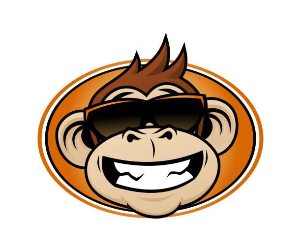 laughing monkey head cartoon mascot in sunglasses - monkey stock illustrations