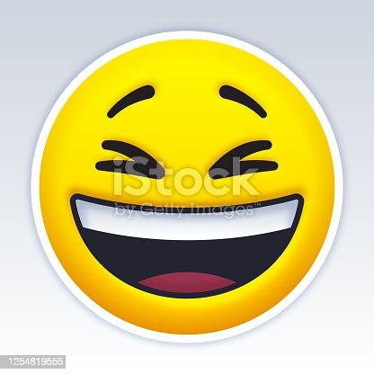 Smiling laughing yellow emoji face.
