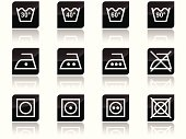 First set of shiny black icons with common laundry care symbols on it.