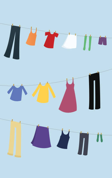 Laundry hanging on a clothesline vector art illustration