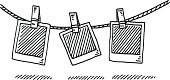 Hand-drawn vector drawing of a Laundry Line and Blank Photographs. Black-and-White sketch on a transparent background (.eps-file). Included files are EPS (v10) and Hi-Res JPG.