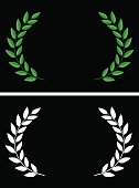 Vector illustration of laurels in flat style and in silhouette.