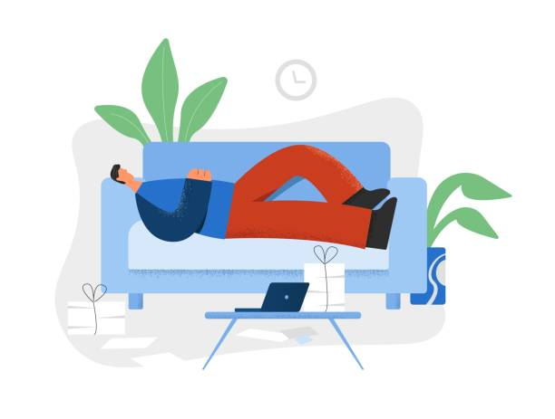 illustrazioni stock, clip art, cartoni animati e icone di tendenza di lazy man lying on couch in front of laptop and heap of documents - divano procrastinazione