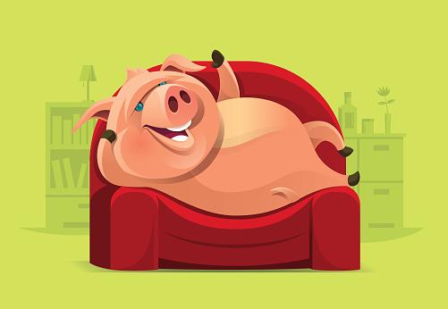 lazy pig lying on sofa and waving