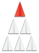 Vector illustration of a red paper airplane followed by five white paper airplanes.