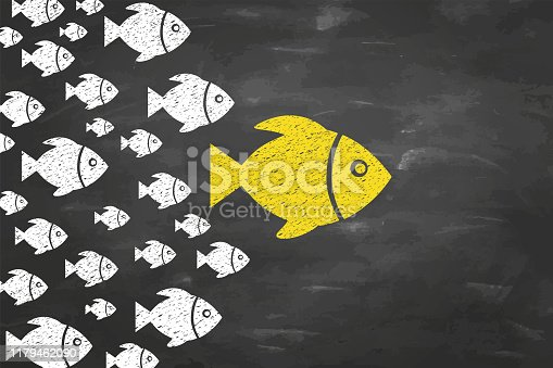 Leadership Concepts with Fishes on Blackboad Background