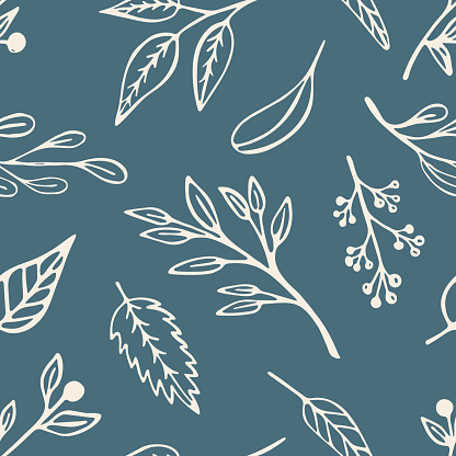 Leaf and sprigs seamless pattern on a green background. Cute beige vegetal design with hand drawn leaves in line art