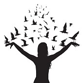 Learning to fly abstract concept with silhouettes of woman and birds