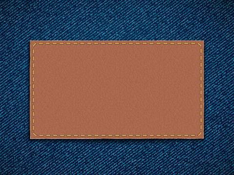 Leather label on denim. Blank template for copy space.