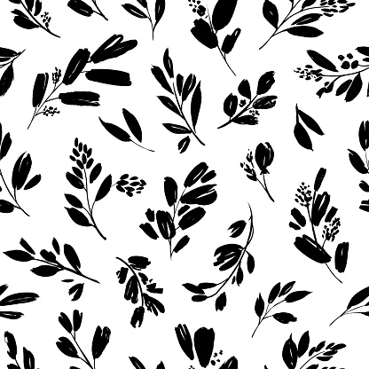 Leaves and branches vector seamless pattern. Black brush leaves, twigs and small flowers. Black branch modern ornament, ink texture with foliage.