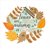 Leaves are falling autumn is calling funny saying, with colorful autumn leaves wreath.  Hand drawn vector text. Autumn color poster. Good for scrap booking, posters, greeting cards, gift, textiles.
