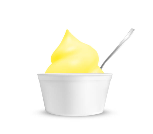 Lemon ice cream in a cup with a spoon Lemon ice cream in a cup with a spoon. pudding stock illustrations