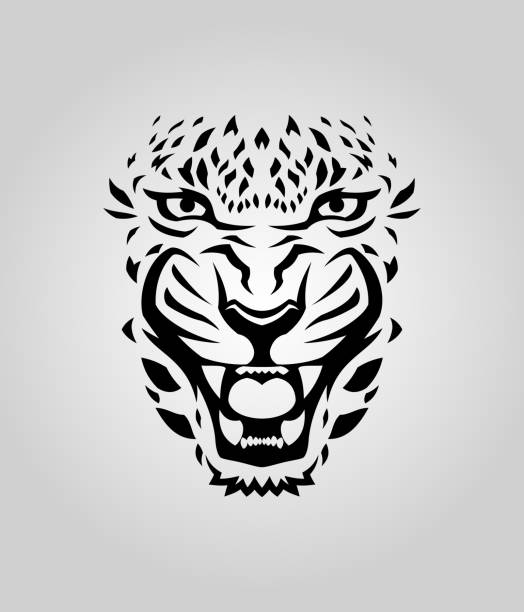 Leopard, tiger, or cougar face cut out silhouette Leopard, cougar or tiger face vector cut out silhouette jaguar stock illustrations