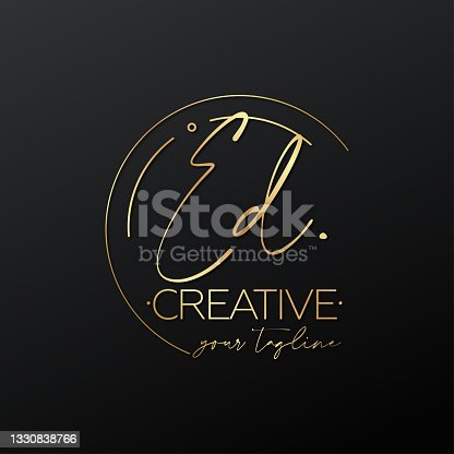 istock ED letter calligraphy minimal emblem style vector logo. Gold color and black background. 1330838766