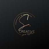 istock S letter calligraphy minimal monogram emblem style vector logo. Gold color and black background. 1317309590