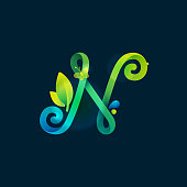 N letter eco logo with green curved lines, leaves and dew drops.