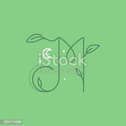 istock M letter logo with graceful with moon, stars and leaves decoration. 1304174336