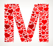 Letter M Icon with Red Hearts Love Pattern. The vector shape is filled with red heart pattern. The red color hearts vary in size, rotation and shade or the red color. The background is white with a slight gradient around the edges. This vector pattern graphic fill is perfect for Valentine's Day Holiday ideas.